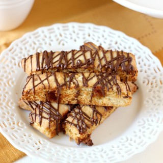 Caramel Almond Biscotti ~ mykitchencraze.com ~ A nice crunchy biscotti, filled with caramel bits and a drizzle of coffee. Perfect with your cup of coffee!