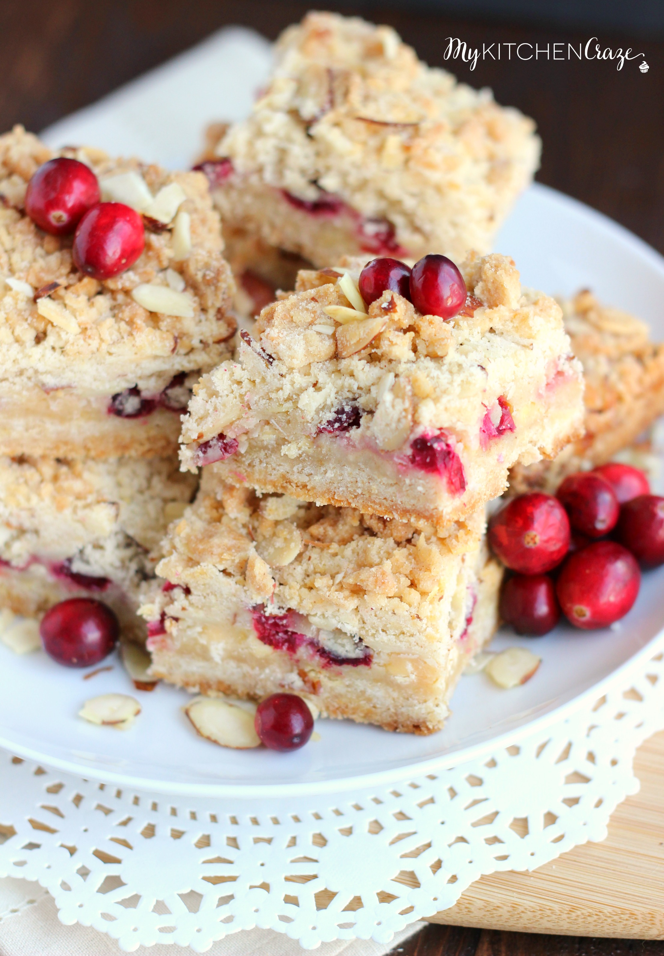 Cranberry Magic Bars ~ mykitchencraze.com ~ A twist on the classic magic bars. These have layers of white chocolate chips, flakey coconut, condensed milk and fresh cranberries. These magic bars will be gone before you know it!