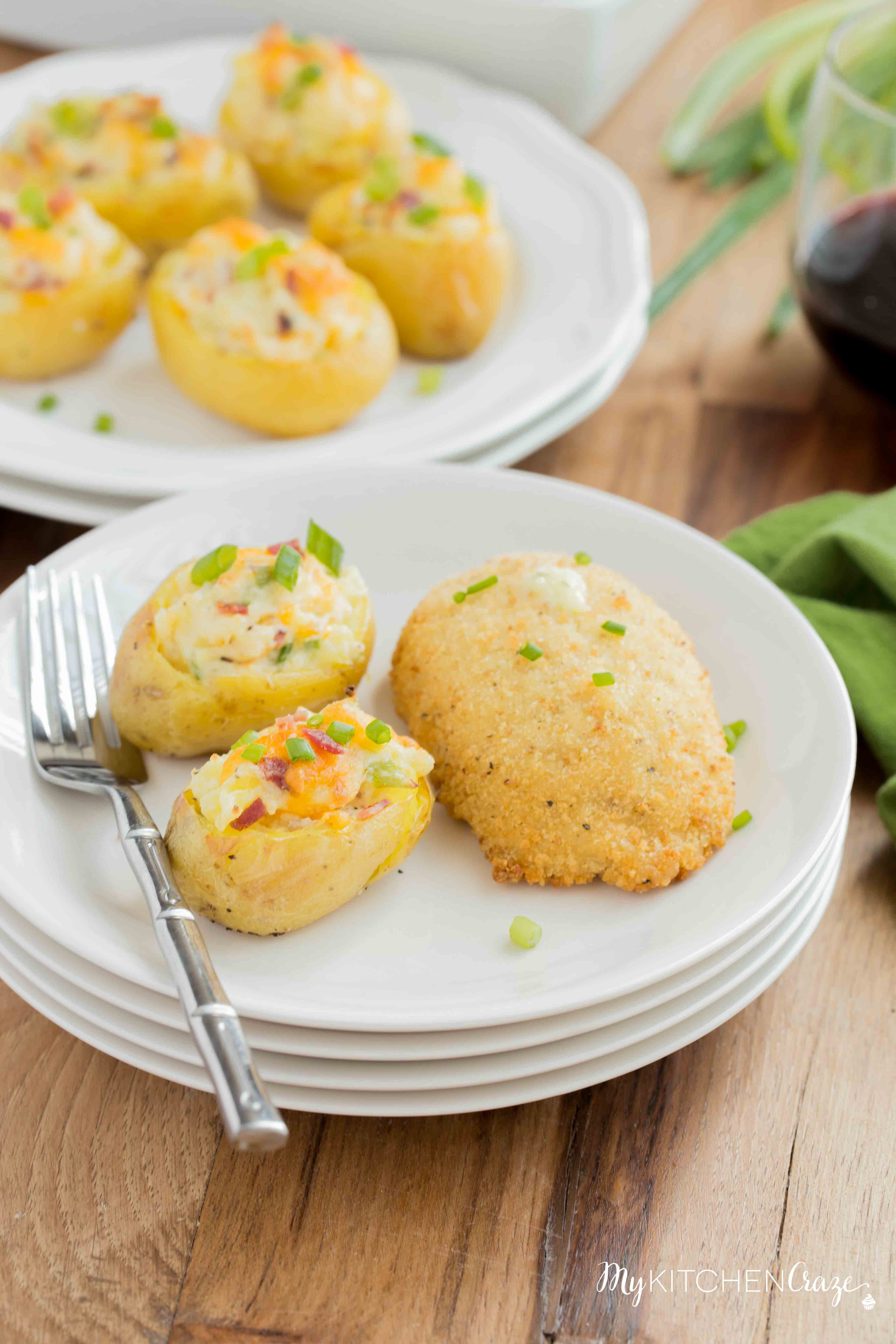 Mini Twice Baked Potatoes ~ Potatoes baked to perfection then loaded with bacon, green onions and cheese. All the yummy things you need for a side! These mini twice baked potatoes are the perfect side.