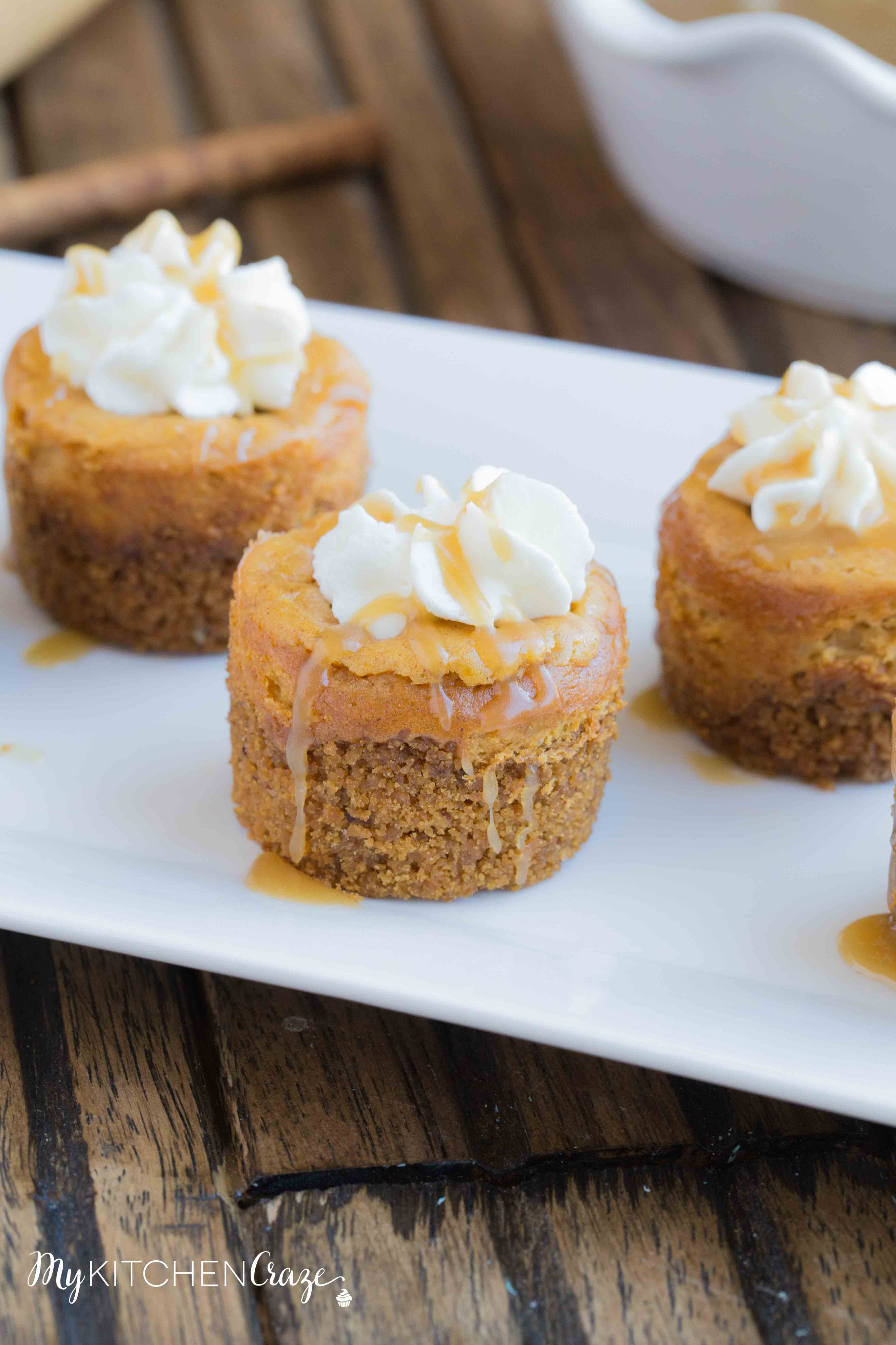 Mini Pumpkin Cheesecakes are the perfect fall dessert! Creamy cheesecake has the perfect hint of pumpkin, topped with homemade whipped cream and caramel sauce. It doesn't get much better than these cute mini cheesecakes this season!