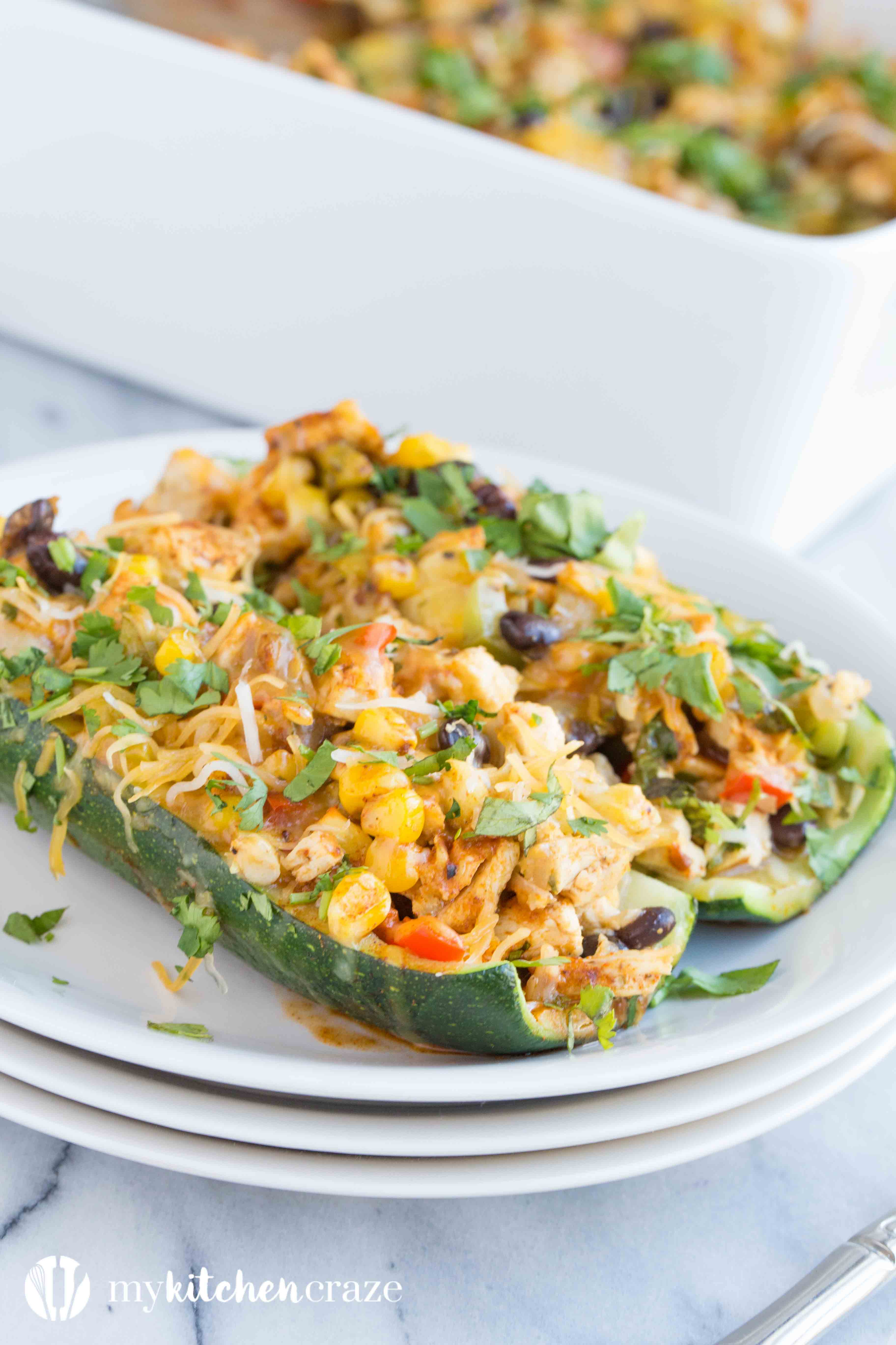 Chicken Enchilada Zucchini Boats are filled with all the same delicious flavors as regular enchiladas, but are healthier! Loaded with tons of veggies and yummy flavors, these enchiladas are great for dinner!