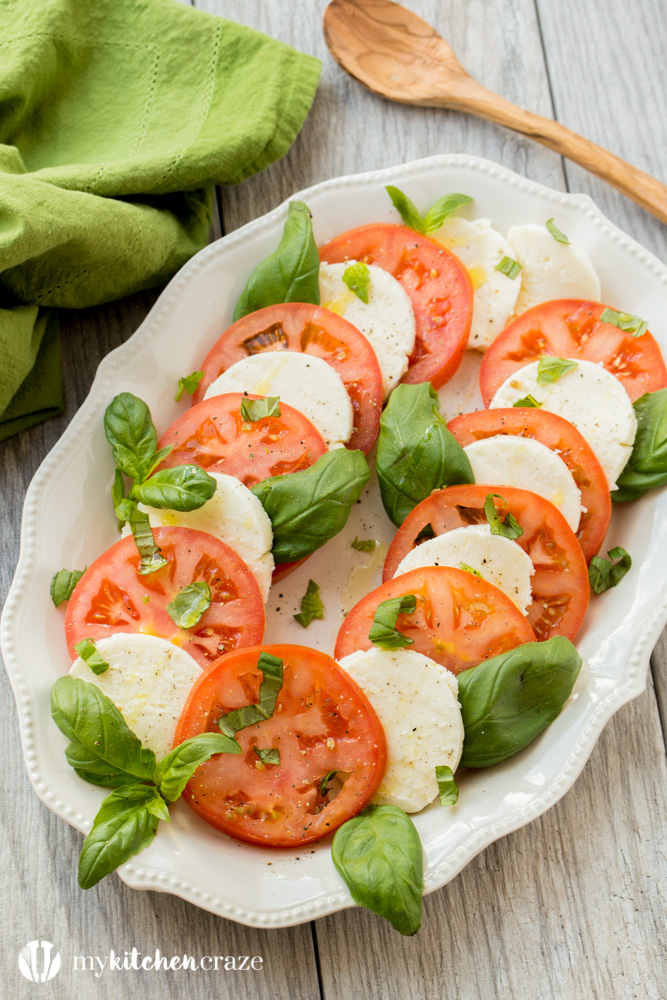 Caprese Salad ~ Tomatoes, fresh mozzarella and basil drizzled with a sweet balsamic reduction and olive oil. What could be better and easier?