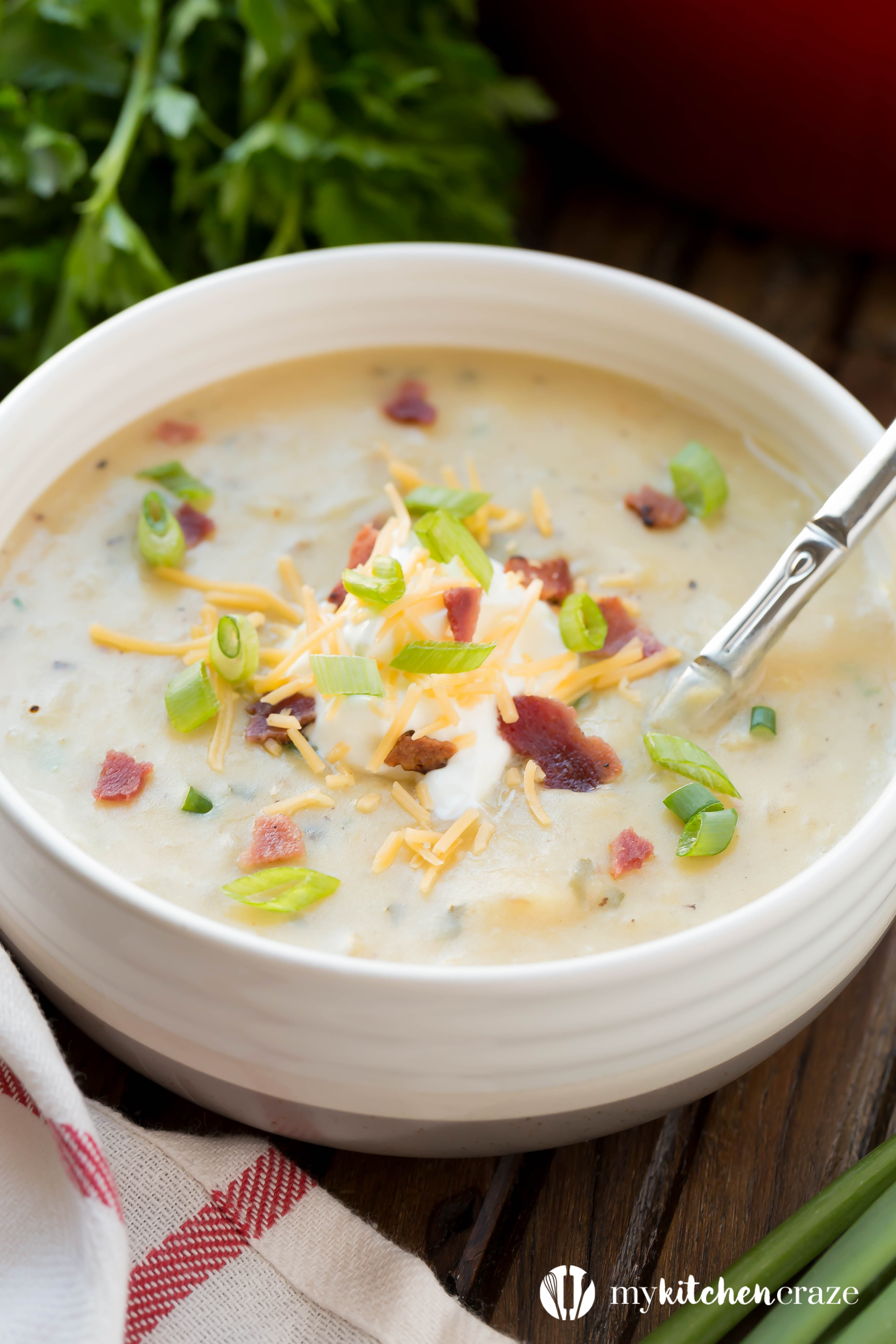Loaded Potato Soup ~ All the goodness of a baked potato turn into a comforting soup and loaded with all the fixins. Guaranteed to be a winner at the dinner table!