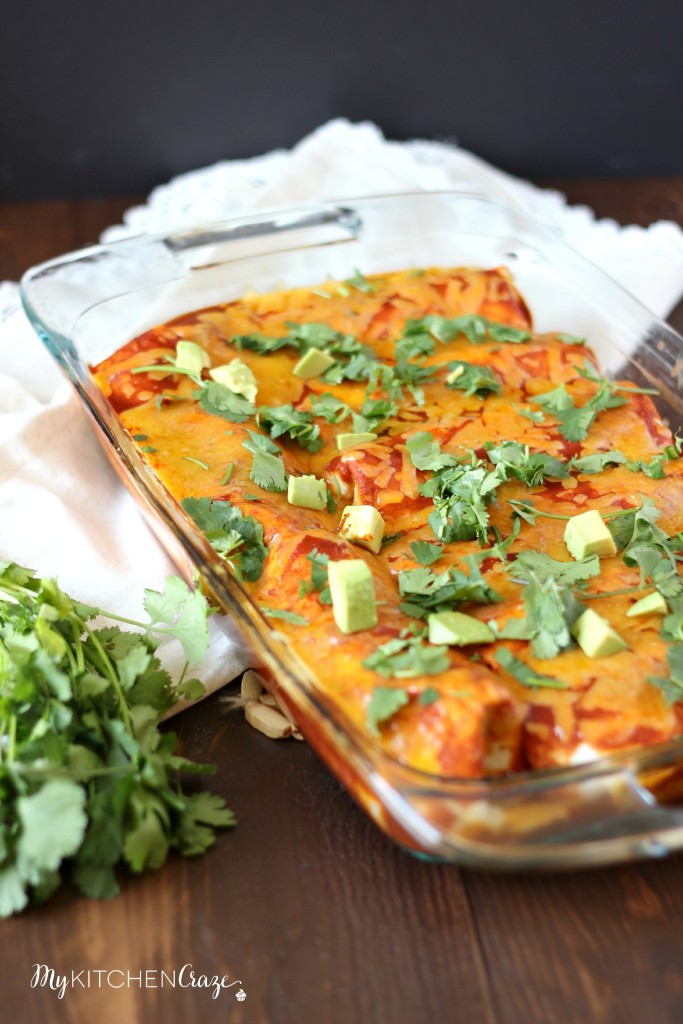 Chicken & Sweet Potato Enchiladas ~ www.mykitchencraze.com ~ Tortillas filled with chicken, sweet potatoes and black beans, then smothered in enchilada sauce and cheese! Delicious!