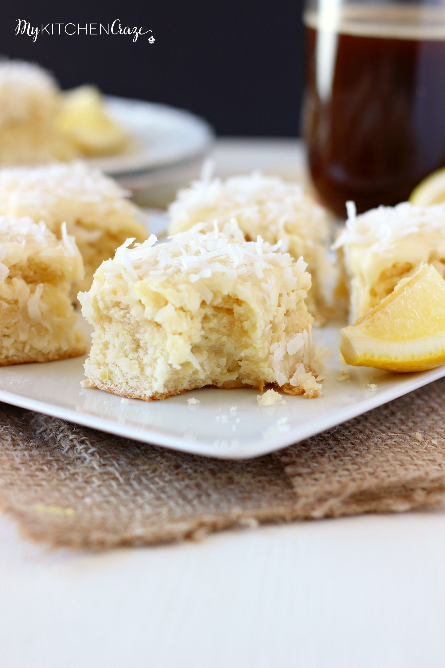 Coconut Lemon Blondies ~ mykitchencraze.com ~ Moist and flavorful coconut lemon blondies, frosted with a creamy white chocolate frosting. These blondies are great for any get together or just because. You'll love them!