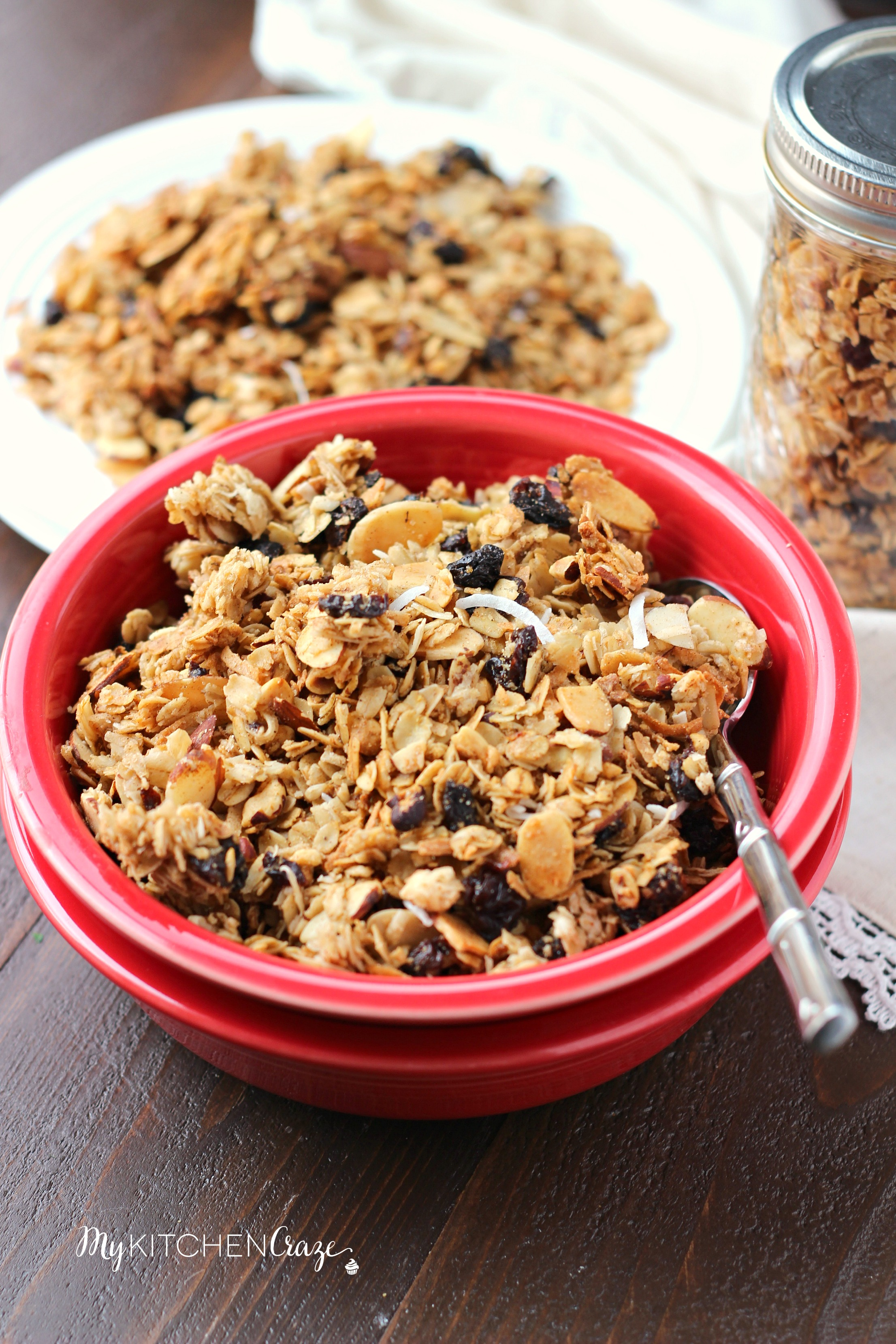 Cherry Coconut Granola ~ mykitchencraze.com ~ A simple and delicious granola made in the comfort of your own home. Made with coconut, dried cherries, almonds and hazelnuts. This granola won't last long in your house!