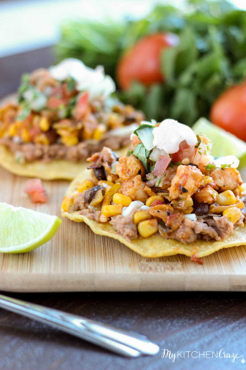 Shrimp Tostadas ~ mykitchencraze.com ~ Enjoy these delicious and scrumptious Shrimp Tostadas in your home. Filled with all sorts of veggies and delicious shrimp. These tostadas will be a winner in your home.