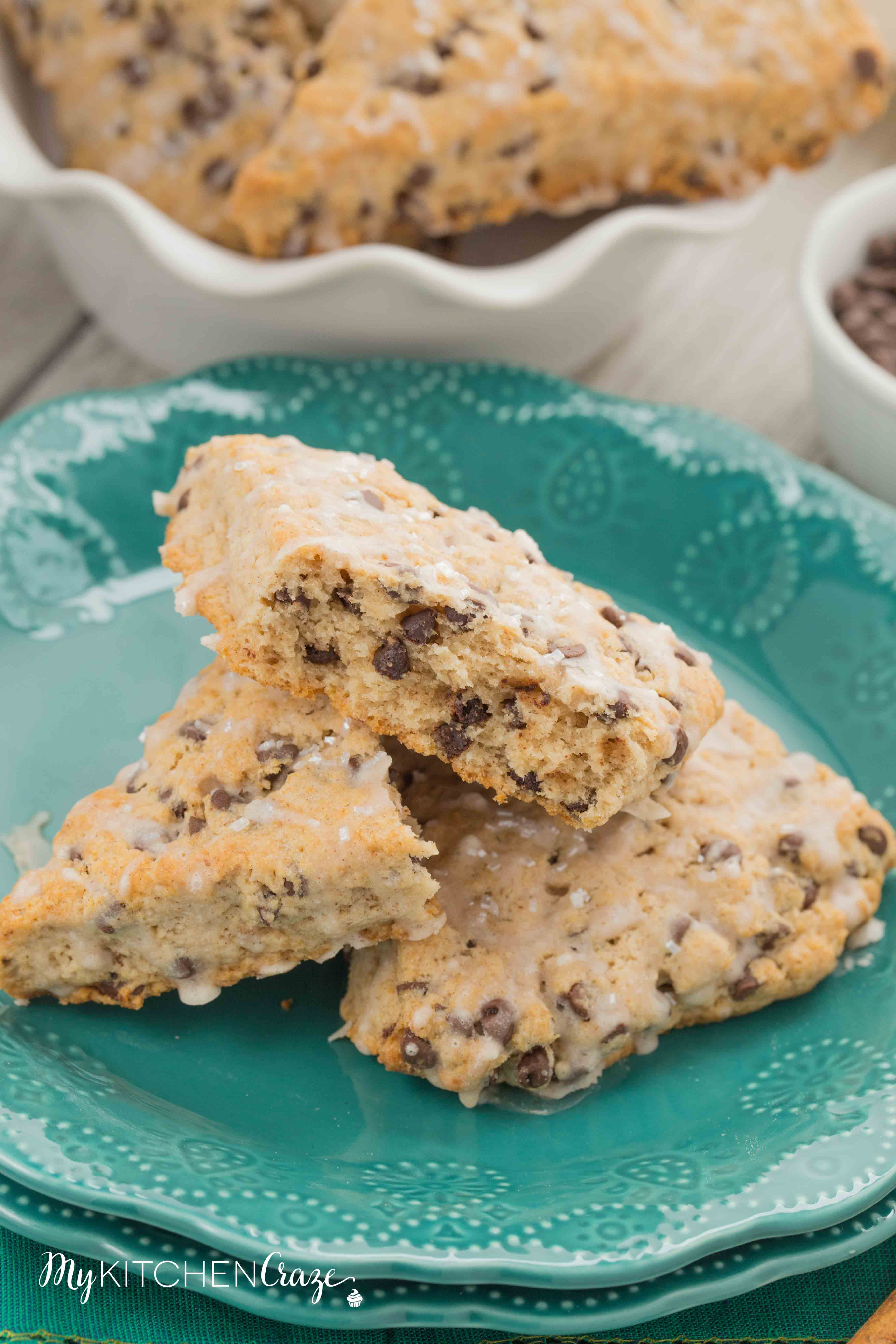Cinnamon Chocolate Chip Scones ~ mykitchencraze.com ~ These scones are packed with chocolate chips and topped with a cinnamon glaze. These are the most delicious scones e-v-e-r! Moist, crumbly and irresistible. Give them a try.