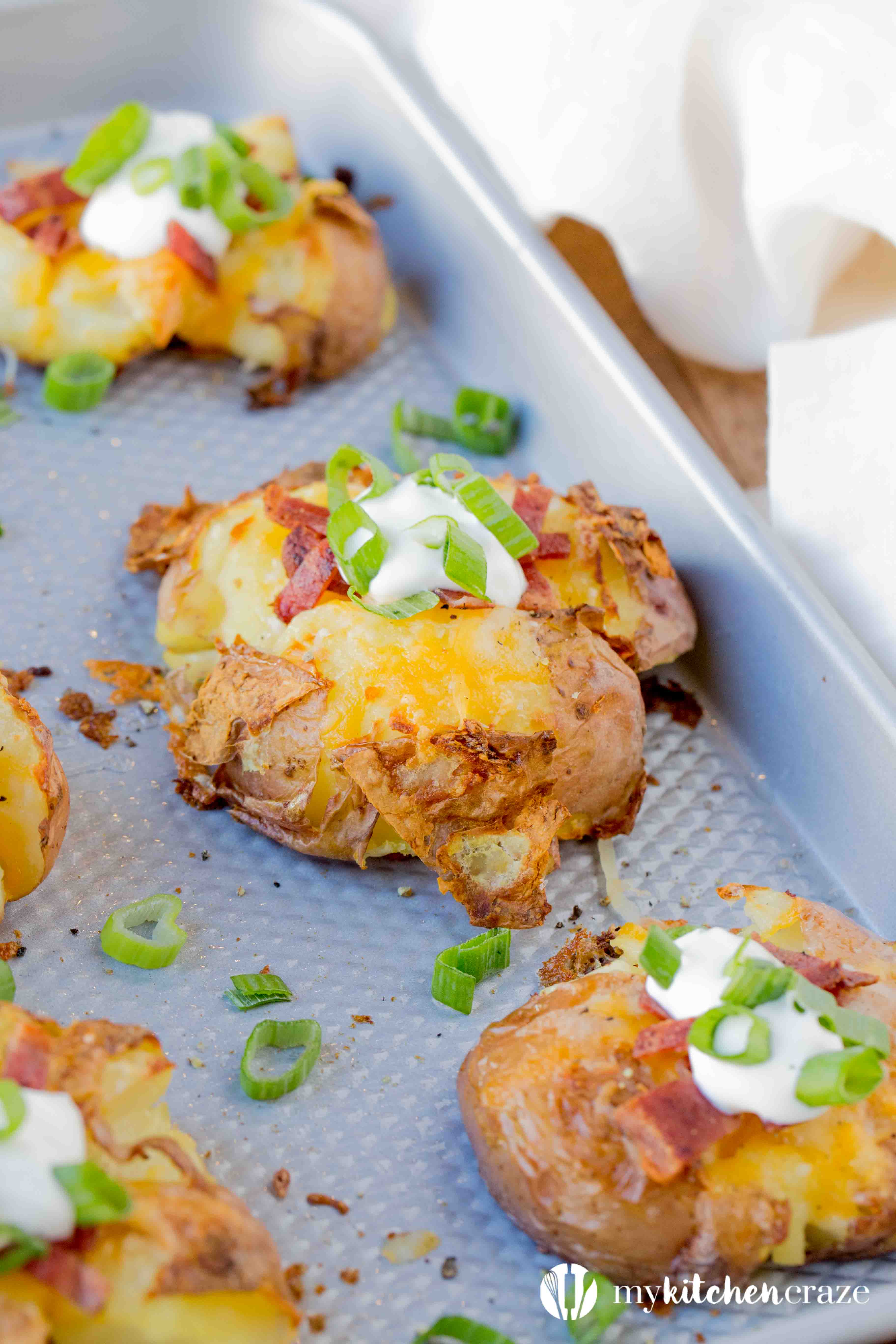 Loaded Smashed Potatoes are a no fuss and delicious side dish. Loaded with all the yummy things you'd find in a loaded baked potato. This is one side everyone will love!