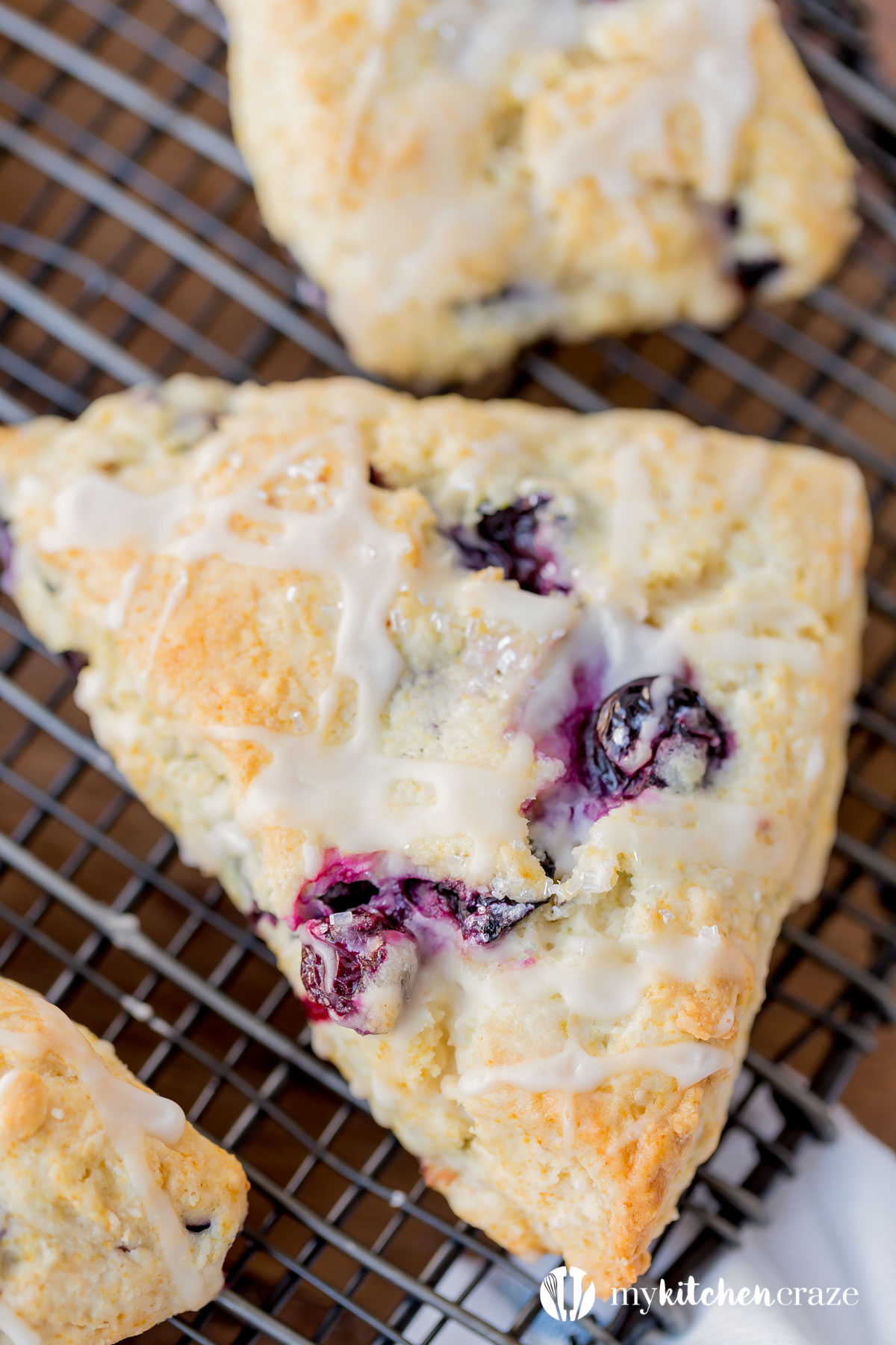 Blueberry Scones with Vanilla Glaze are perfect for a quick grab and go breakfast. They're crunchy around the edges but moist in the center. Topped with a vanilla glaze to give them a bit of sweetness.