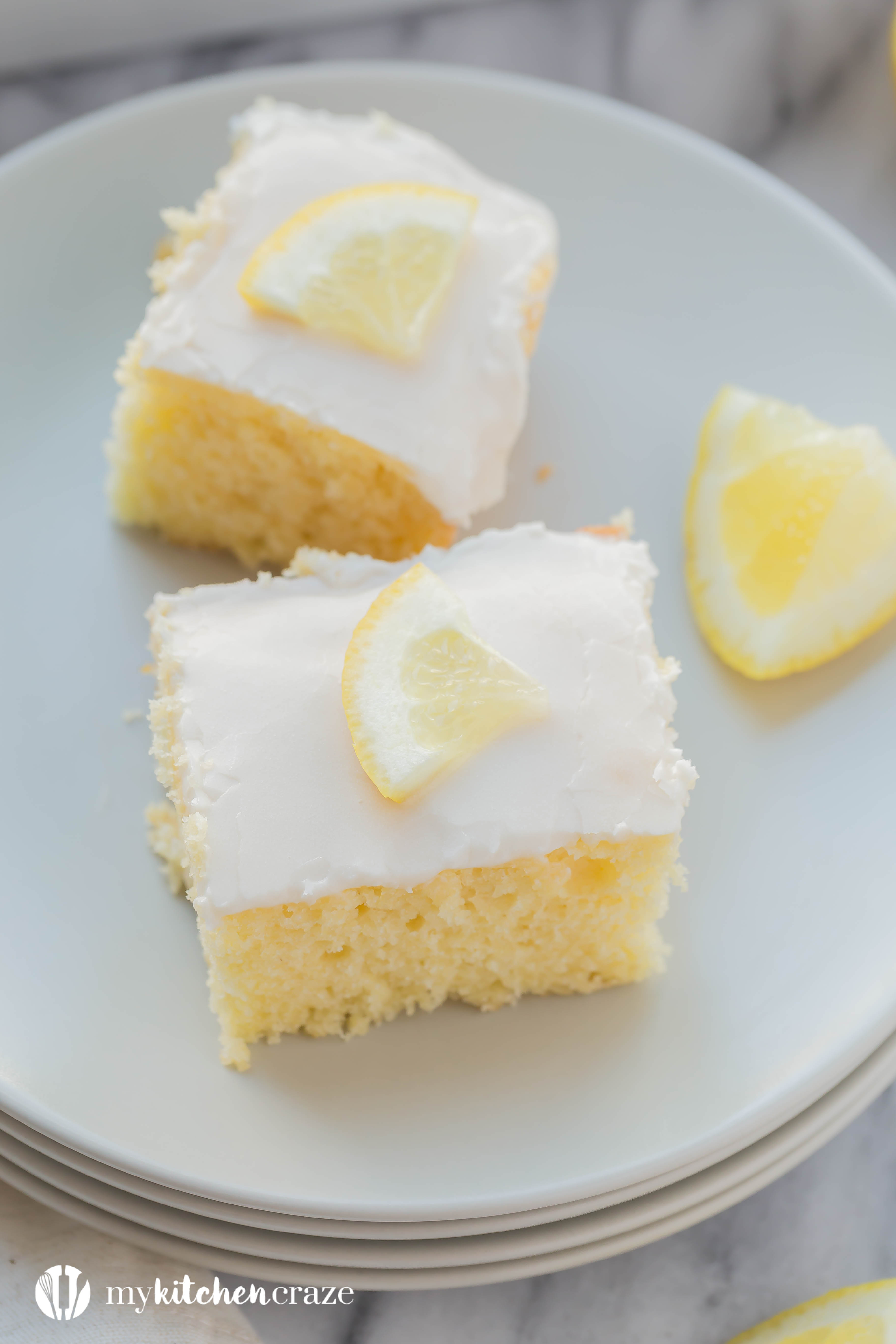 Lemon Velvet Squares are moist and packed with lemon flavor. Topped with a simple lemon glaze, these are one dessert you won't want to pass up. Includes a how to make video too.