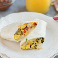 Do you skip breakfast in the mornings because you're just way to busy? Well not any more. Prepare there Freezer Breakfast Burritos during the weekend and have them all week long. Loaded with eggs, sausage, potatoes and of course cheese, these burritos will keep you full all morning long.